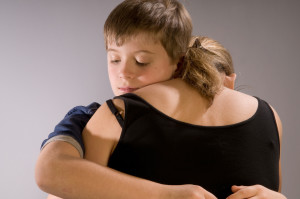 Emotional hug, boy and his mother
